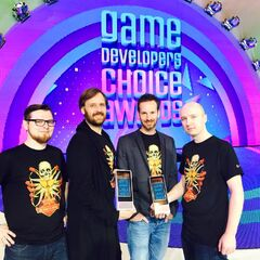CDPR team wearing T-shirts with first appearance of the logo at the Game Developers Convention 2016