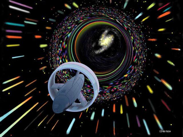 File:Spaceship-traveling-through-wormhole.jpg