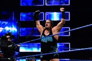 Rhyno holding the tag-team champion