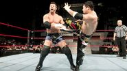Tajiri kicking Gregory Helm