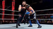 Kevin-Owens headlocking Styles