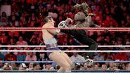 Simon leg kicked by R-Truth