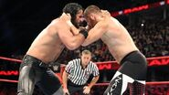 Sami and Seth grappling each other
