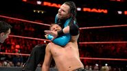 Jeff-Hardy locking Curtis-Axel in