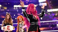 Becky overlooking Sasha at WrestleMania 32