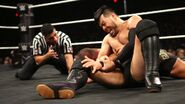 Itami stretching Roode wrist