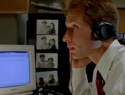 Fox Mulder backdropped by photographs of himself and Samantha Mulder