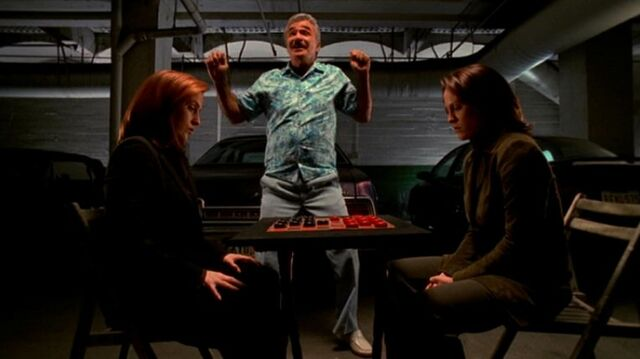 File:Mr. Burt dances as Dana Scully and Monica Reyes play checkers.jpg