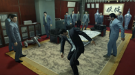 Kuze watches Kiryu hit one of Dojima's men