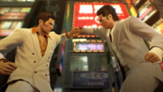 Kiryu grab Kuze's fist tight