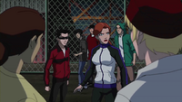 Batgirl and Robin infiltrate prisoners