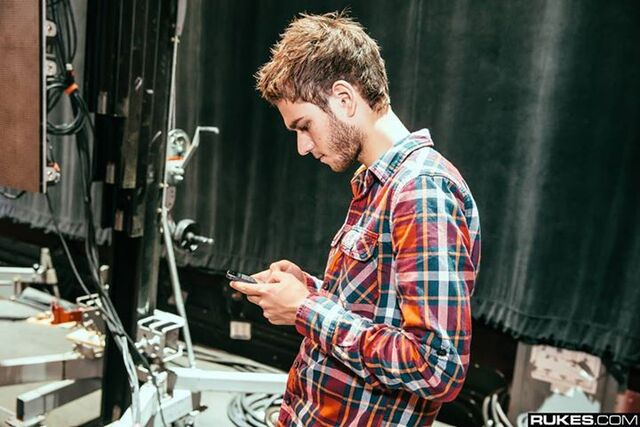 File:Zedd on his phone.jpg