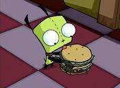 GIR licks a hamburger