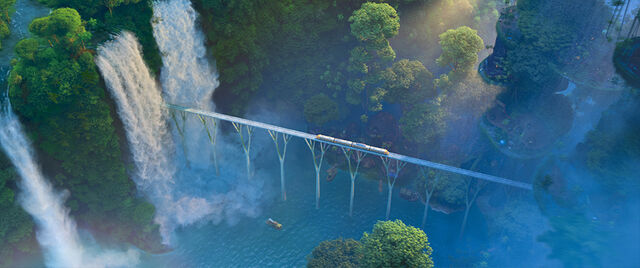 File:Train over Rainforest District.jpg